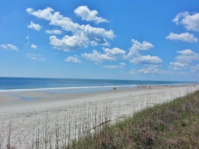 Photo for December Discount! Luxury Condo with Ocean View:   Steps Away from the Beach!