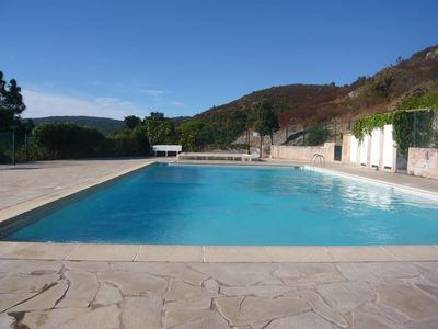 Photo for Lovely apartment with Garden, Terrace, Pool, Tennis court and Beaches, sleeps 4