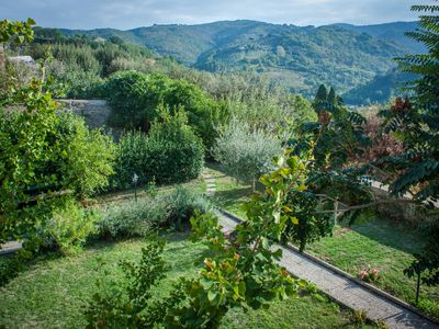 Photo for 14th Century cute flat with garden on a hill facing Assisi
