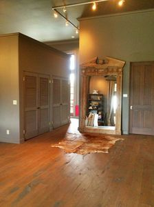 huge coat closet.door to laundry room.Open area for more tables or gallery.