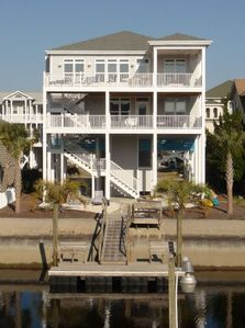 Photo for PEND 9, Pristine canal home with reverse floor plan and large decks, short walk to the beach.