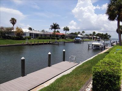 Photo for 3 bedroom 2.5 bath Spacious Canal Front home with a Pool and fishing Dock. Sleeps 6