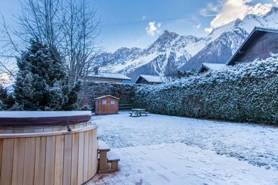 Relax in the cedarwood hot tub whilst looking onto the Mont Blanc Massif