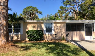 Photo for Newly Renovated! Charming & Quaint, on pond. MINUTES from MANASOTA KEY beaches!