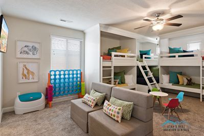 The coolest bunk room setup with play furniture