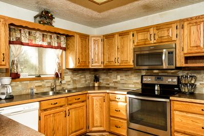 Enjoy preparing meals together in the fully equipped, modern kitchen.