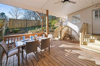 Dine out on the backyard`s covered porch.