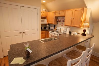 Full kitchen and breakfast bar allow you to eat in if you prefer.