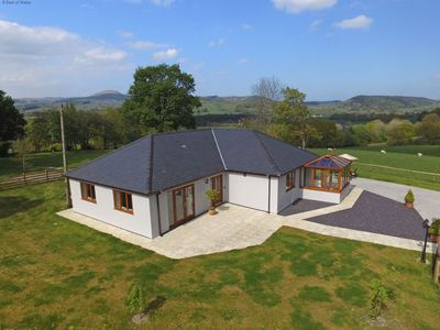 Photo for Spacious cottage in a tranquil location with spectacular views over the Dee Valley. 1 mile to the ma