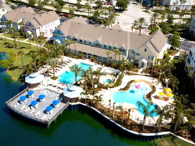 Aerial view of lagoon, seasonally heated pools and clubhouse