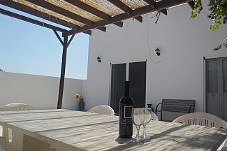 The front patio of our villa, granite table for 8, shaded with vine & pergola
