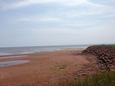 Photo for Stunning Ocean Front Summer Home /Red Sand Beach of PEI's South Shore