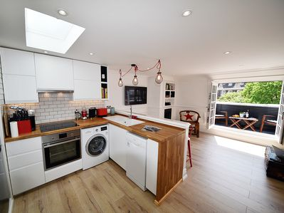 Open plan kitchen area with soft closing doors