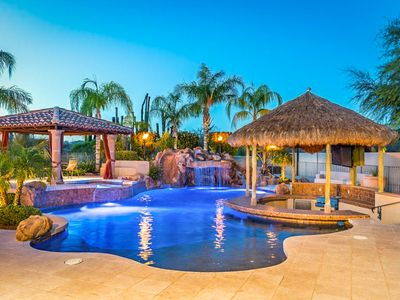 Photo for NEW LISTING! Luxury home with pool and spa, swim up bar, theater room and more!