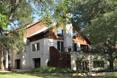 Three story ranch house sits beside the creek