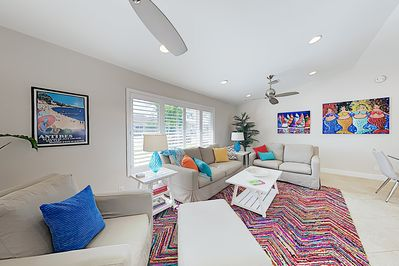 Living Room - Pops of color create a contemporary vibe in the living room, furnished with a queen-size sleeper sofa.