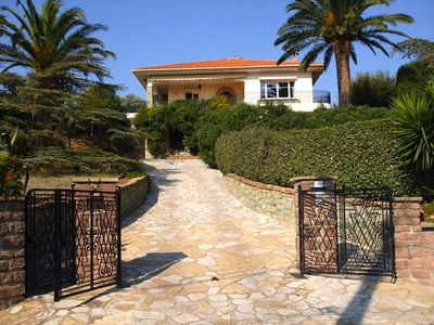 Photo for Luxurious villa with fantastic sea view and pool near beach and town
