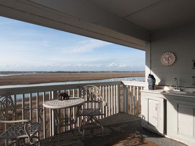 Photo for Live luxuriously with marsh views, boat slip, sparkling pool & tennis courts
