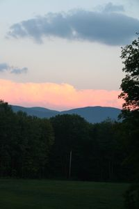 View of Mountains from cabin at sunset - clouds rolling up valley