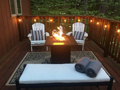 Relax by the fire pit on the back deck