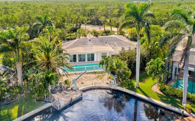 Photo for Now Open for Jan 2019!  Huge discounts to Stay on Sanibel Jan 2019! Heated Pool - Private Dock !