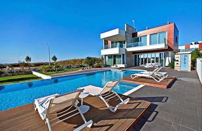Photo for Villa Heracles - Amazing 3 Bedroom Luxury Villa on 2 Floors with Private Infinity Pool and AC, only 70 Meters to the Beach ! FREE WiFi