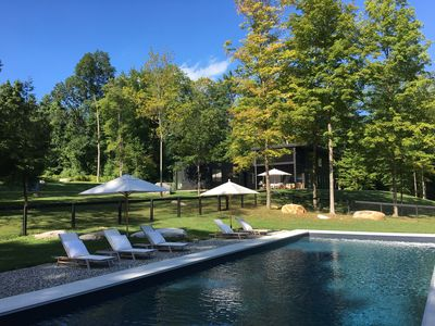 Photo for Luxurious modern estate w/ heated pool, hot tub, and lakefront!