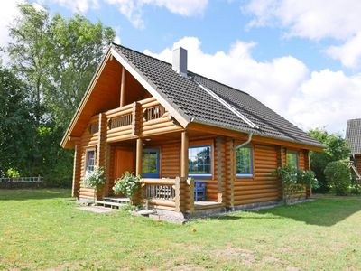 Photo for 4 star log cabin with fireplace, WiFi and garden for 4 people