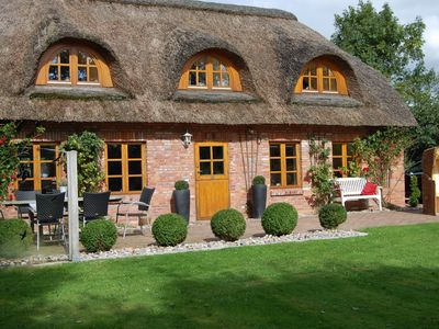 Photo for Beautiful well-kept thatched cottage in Tating WLAN, sauna, fireplace, quiet location
