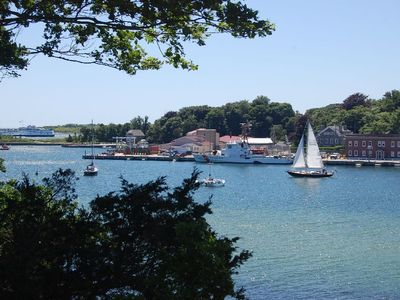 Photo for Ocean front, secluded, large deck above harbor, panoramic views of Woods Hole