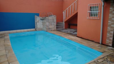 Photo for Home with pool and games room, airy and comfortable, close to the beach.