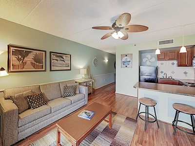 Photo for Walk to Downtown Shops! Waterside Condo w/ Private River-View Balcony