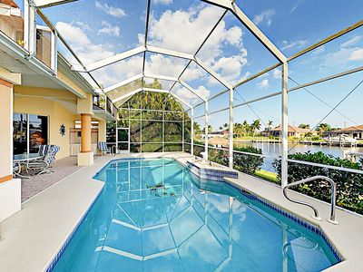 Photo for Canal-Front 3BR w/ Pool & Dock – Close to Tarpon Point Marina & Restaurants