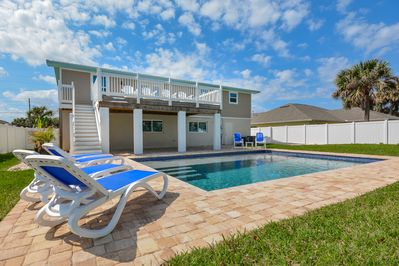 Beautiful home with large pool and fenced in backyard.