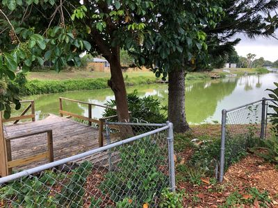 Photo for 5 Br Pool/Cage, Lake, Dock, A/C, fenced yd PET!