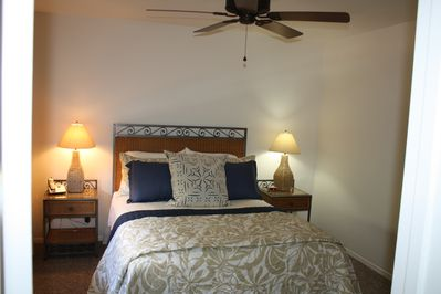 Queen size bed in private bedroom for guests nightly slumber