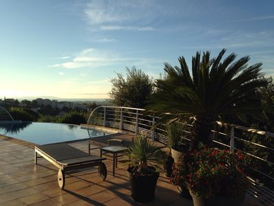 Photo for Contemporary villa Pool sea view facing the islands of Porquerolles and Port Cros