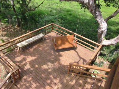 Large deck with swing