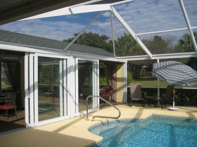 Photo for Nice 3 bed room/2 bath room villa with private pool and a great Florida room