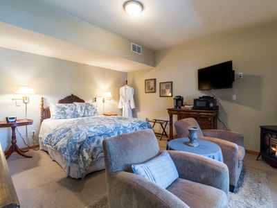 Photo for All Seasons River Inn Suite E -Riverfront & cozy gas fireplace, private patio!
