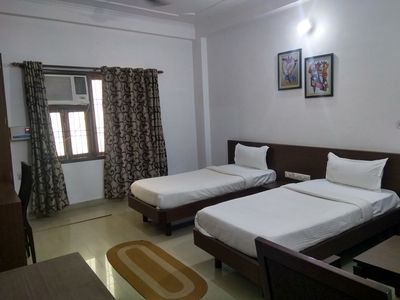 Photo for Three well furnished air conditioned rooms with attached toilet