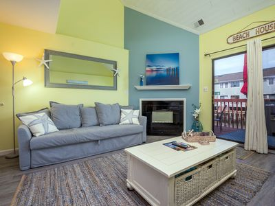 Photo for Cozy two-level townhouse with decorator touches located on the water!
