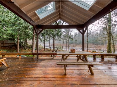 Photo for Lovely riverfront home with spacious deck and forest views - dogs OK!