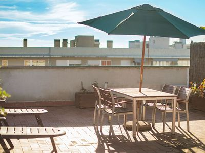 Photo for Beach Comfortable Flat apartment in Barceloneta with air conditioning, private parking, private ter…