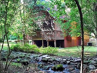Photo for FREE ATTRACTION TICKETS, Private Cabin, Mountain Stream, Screened Porch, HOT TUB