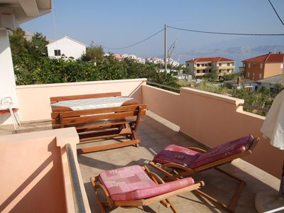 Photo for Two bedroom apartment with terrace and sea view Pag (A-6467-a)