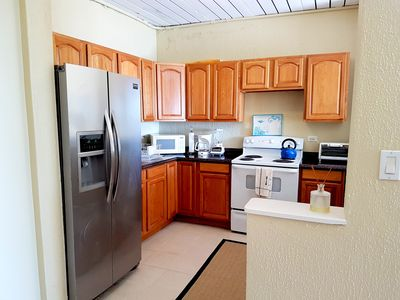 Full kitchen with stove, oven, ice maker, microwave, toaster oven, plates, etc.