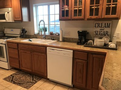 Beautiful new kitchen with new dishwasher, sink and faucet sprayer combo