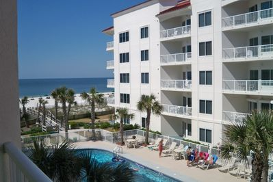 A view from the balcony to the Pool and Beach