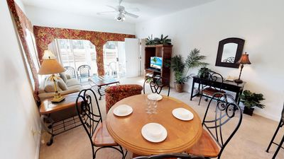 Photo for Beautiful Golf View Condo with Screened Porch & Full Kitchen - Pools included with beach < 1.5 mi!